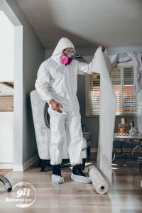disaster restoration professional working in a home
