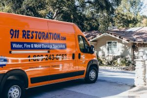 sewage backup cleanup vehicle parked in front of house